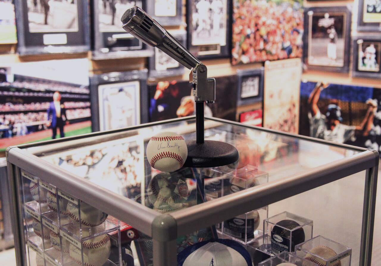 A Vin Scully microphone and signed baseball.